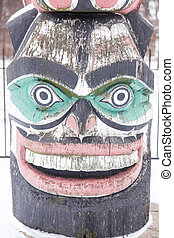 Kwagulth Totem Pole - Kwanusila, the Thunderbird, is an...