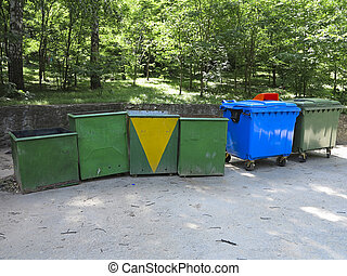 Old and new colorful garbage containers in park - Old and...