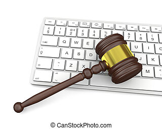 Law in technology - Wooden gavel on computer keyboard,...