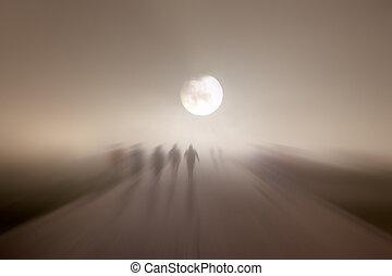 Blurred people walking in a pedestrian street in a foggy...