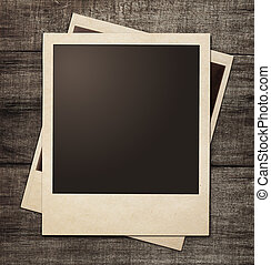 polaroid photo frames on wooden grunge background