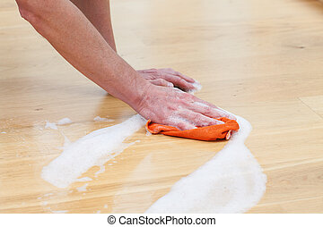 Wet cleaning rag - A man cleaning the floor with a wet rag