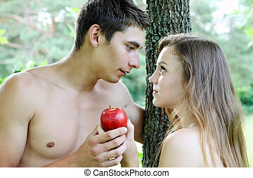 Eve tempted Adam - Adam and Eve with a red apple