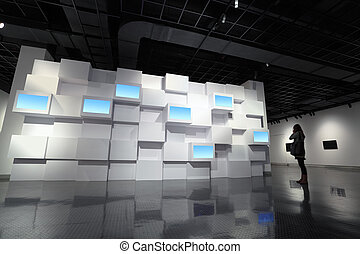 video wall and audience in a exhibition room