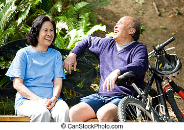 Senior asian couple - A shot of senior asian couple sitting...