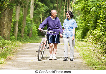 Senior asian couple - A couple senior asian talking while...