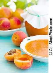 fresh apricots and apricot jam, still life
