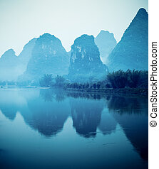 beautiful yangshuo hills and reflection in lijiang river