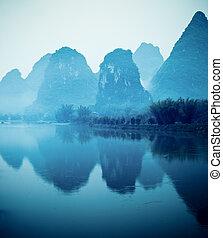 beautiful yangshuo hills and reflection in lijiang river
