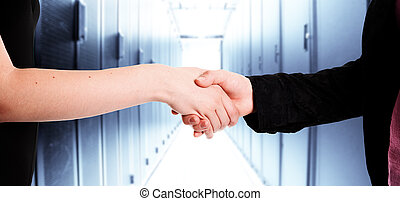 Business handshake - Two businesswomen handshake in a data...