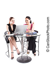 Business meeting - Two businesswomen having a meeting at the...