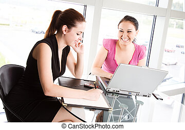 Businesswomen meeting - Two businesswomen in a meeting at...