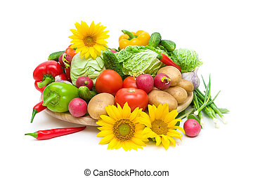 vegetables and sunflowers on a white background