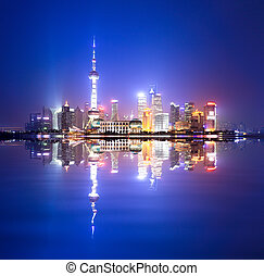 shanghai skyline at night,and reflection in the huangpu...