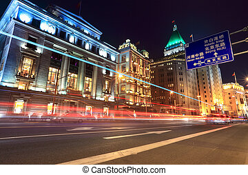 light trails on the street in shanghai bund - light trails...