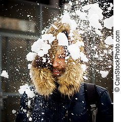 Young man throwing snow - Young man is getting hit by a...