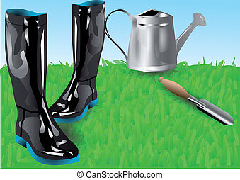 garden tools. boots with shovei on green grass