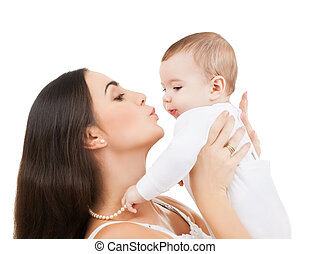 happy mother kissing her child - family and motherhood -...