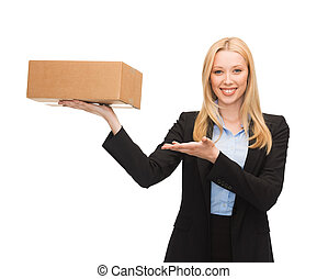 businesswoman holding cardboard box - picture of young...