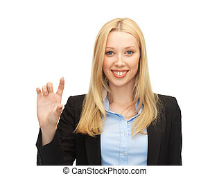 businesswoman holding something imaginary - picture of...