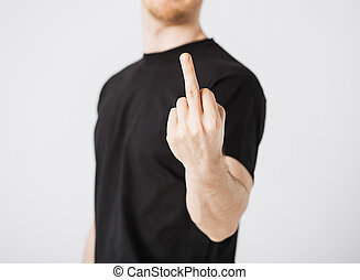 man showing middle finger - close up of man showing middle...