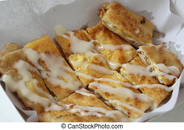 Roti - Dessert style of fried Roti cooking on the street in...