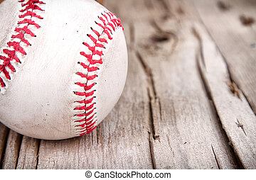 Baseball on wooden background - Close-up of baseball on...