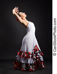 Spanish woman dancing flamenco on black - Flamenco dancer in...