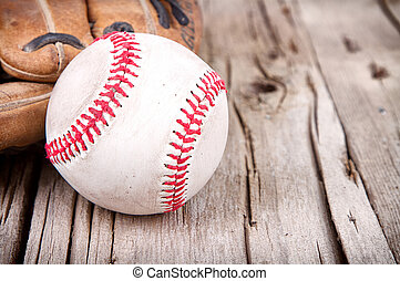 baseball and mitt on wooden background - Close-up of...