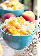 Peach Cobbler - Fresh peach cobbler served outdoors.