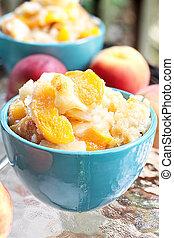 Peach Cobbler - Fresh peach cobbler served outdoors.