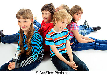 back to back - Group of cheerful children sitting on a floor...
