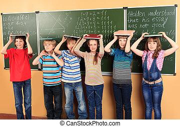 children in classroom - Group of happy schoolchildren...