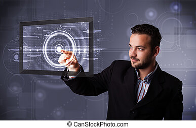 Young businessman touching modern technology tablet