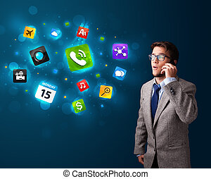 Young man calling by phone with various icons - Handsome...