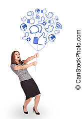 Happy lady holding social icon balloon - Happy young lady...