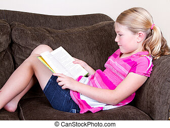 child reading a book - Child reading a book while relaxing...