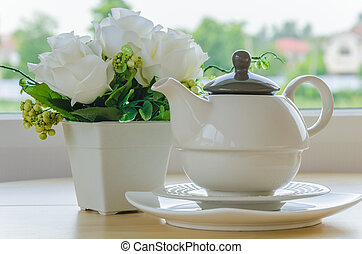 Tea pot on the wood table