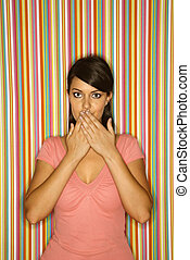 Woman with hands over mouth. - Young adult female Caucasian...