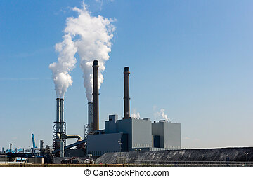 Power plant - power plant against a blue sky with fumes