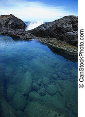 Tidal pool in Maui, Hawaii. - Tidal pool with wave crashing...
