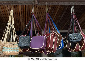 Handbags on open market display - Handbags display on open...