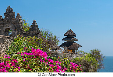 Balinese temple and pink flowers - Pura Luhur Uluwatu...