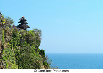 balinese temple on rock above blue tropical sea - Pura Luhur...
