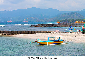 Traditional Balinese boat on a beach - Traditional fishing...