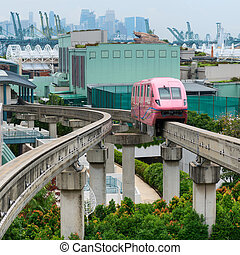 Short monorail train in bright pink flower, Sentosa island,...