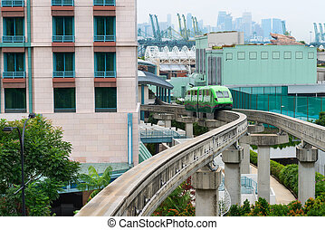 Short monorail train in bright green flower, Sentosa island,...