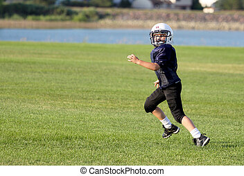 Youth Football Receiver - Youth football player, in pads and...