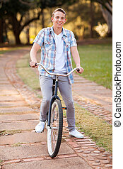 teenage boy riding a bicycle