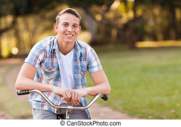 teen boy with his bicycle - cheerful teen boy with his...